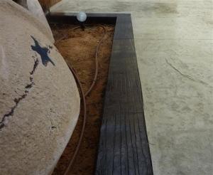 אדן רכבת בהטבעת בטון תוחם ריצוף בטון מוטבע